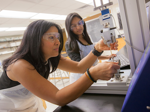 Biomedical engineering student and faculty member conducting a clinical trial