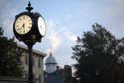 Widener clock with Old Main dome in the background